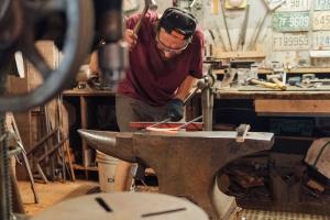 Thomas Lefebvre forging a fireplace tool set